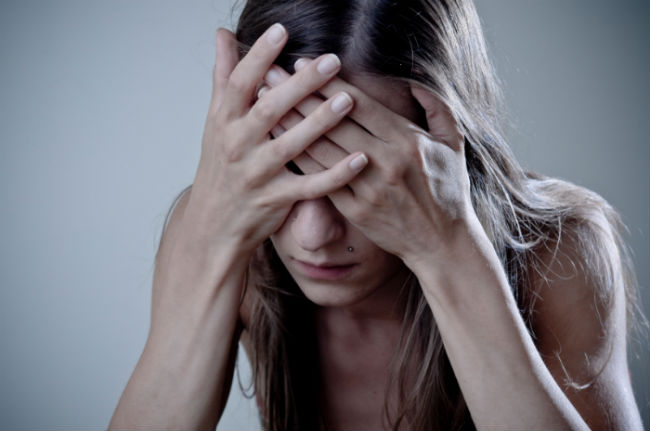 young woman experiencing negative emotions