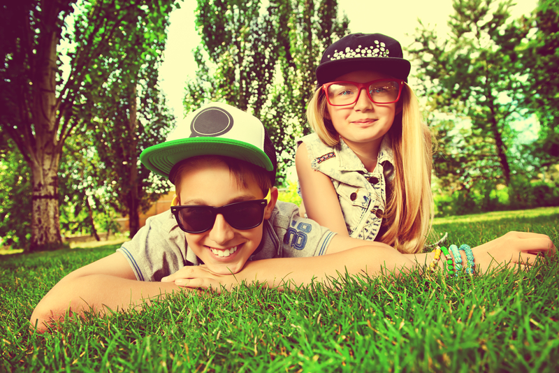 Young friends laying on the grass in a park, having fun.